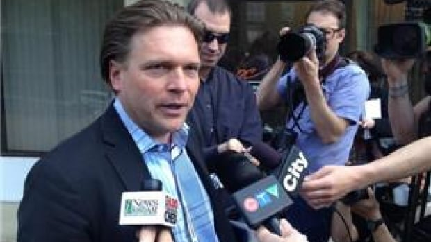 Thomas Lukaszuk speaks to reporters before filing his nomination papers at PC headquarters in Edmonton on Friday afternoon.