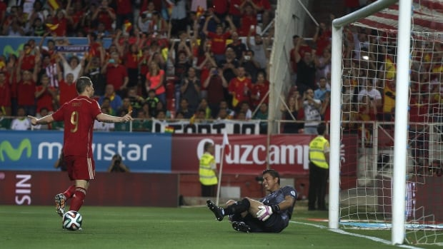 Spain's Fernando Torres, left, celebrates after scoring as Bolivia's goalkeeper Roquel Quinonez reacts during their friendly soccer match in Seville on Friday.