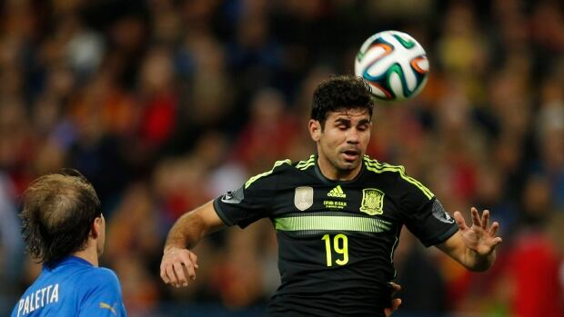 Spain's Diego Costa, right controls the ball in front of Italy's Gabriel Paletta during a friendly in Madrid on March 5.