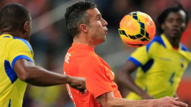 Netherlands' Robin van Persie, right, battles with Ecuador during a May 17 exhibition in Amsterdam.