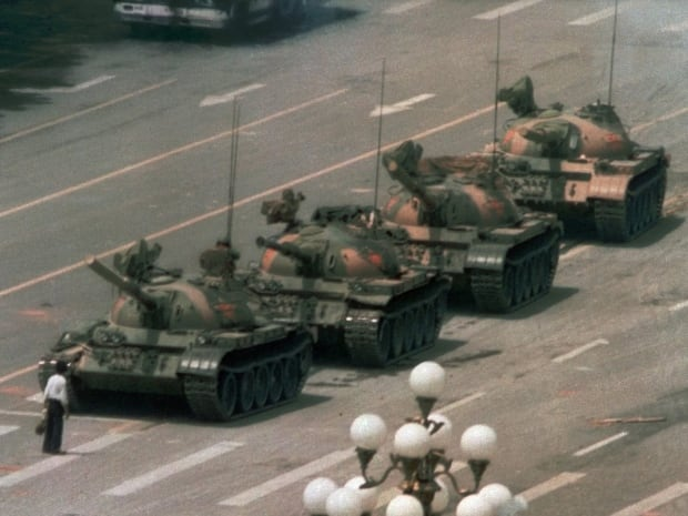 A Chinese man stands alone to block a line of tanks heading east on Beijing's Cangan Blvd. in Tiananmen Square on June 5, 1989. Here are 10 iconic images as the world marks the 25th anniversary of the protest in China.