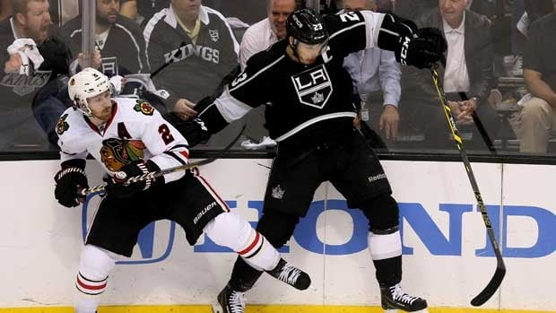 Los Angeles Kings captain Dustin Brown, right, and Chicago defenceman Duncan Keith battle along the boards in Game 6.
