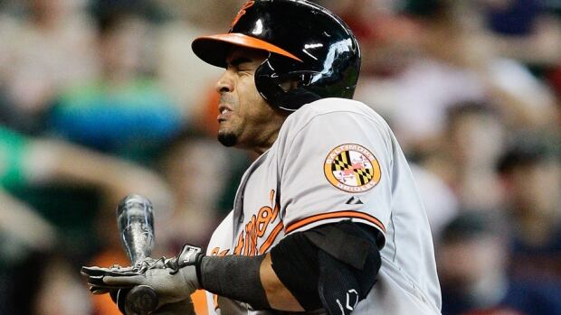 Orioles outfielder Nelson Cruz grimaces in pain after Houston right-hander Scott Feldman hit him with a pitch in the third inning on Sunday. Cruz began the day leading the major leagues with 20 home runs this season.