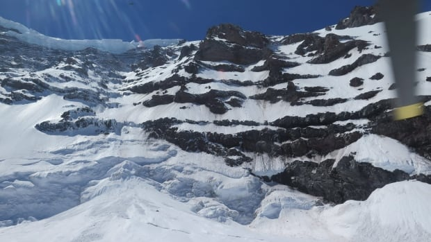This photo provided by the National Parks Service, shows the Liberty Ridge Area of Mount Rainier as viewed from the Carbon Glacier, Saturday, May 31, 2014, in Washington state. Six climbers reported missing on Mount Rainier are now presumed dead.