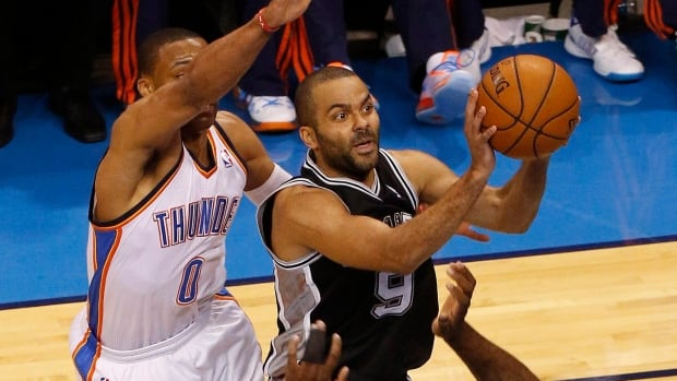San Antonio Spurs guard Tony Parker takes a shot against Oklahoma City Thunder guard Russell Westbrook and centre Kendrick Perkins in the first half of Game 4 of the Western final.