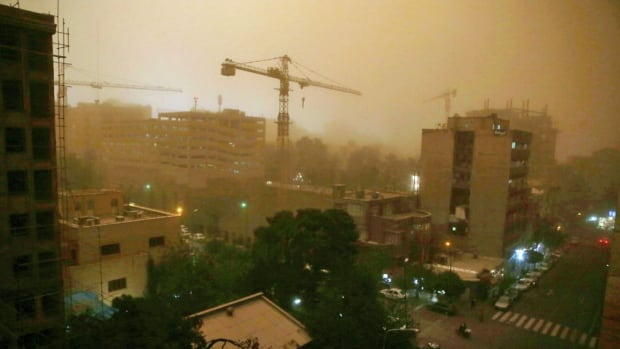 A view of Tehran on June 2 shows a flash dust storm shrouding the Iranian capital. State TV was reporting that the storm had killed at least two people.