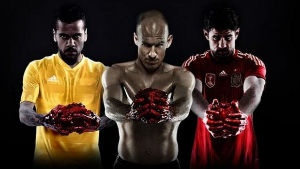 This Adidas ad for the 2014 FIFA World Cup shows players willing to give it all for their home countries, while holding a bloody heart ... from a cow.
