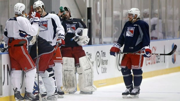Marc Staal, left, Cam Talbot, Brian Boyle, Henrik Lundqvist and Daniel Carcillo take a break from practice in Greenburgh, N.Y.