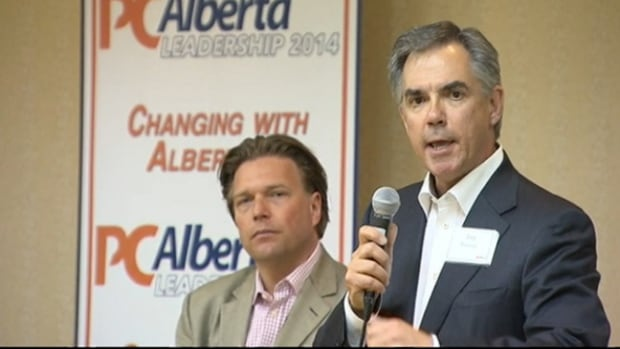 Jim Prentice addresses the crowd at Monday's PC leadership launch while Thomas Lukaszuk looks on.