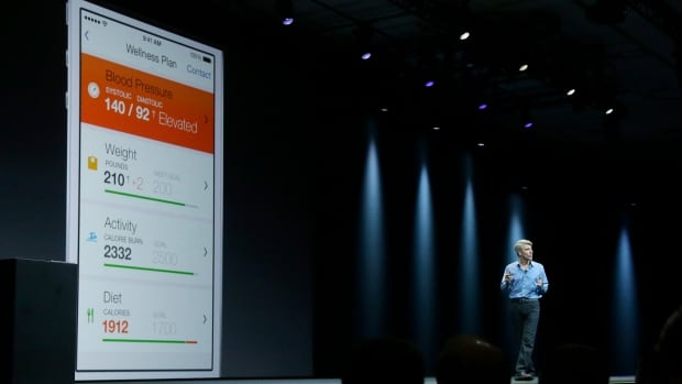 Apple senior vice president of Software Engineering Craig Federighi speaks about the Apple HealthKit app at the Apple Worldwide Developers Conference in San Francisco, Monday, June 2, 2014. (AP Photo/Jeff Chiu)