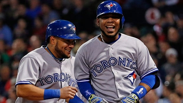 Toronto Blue Jays first baseman Edwin Encarnacion, right, Encarnacion belted a club record 16 home runs last month and batted .281 with five doubles, one triple and 33 RBIs.