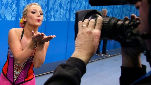 Kirsten Moore-Towers blows a kiss to a camera after competing at the Sochi Olympics.