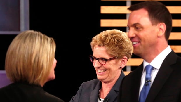 Who will be smiling on election day? Ontario NDP Leader Andrea Horwath, Ontario Liberal Leader Kathleen Wynne, centre, and Ontario Progressive Conservative Leader Tim Hudak speak after taking part in the Ontario provincial leaders debate in Toronto on Tuesday.
