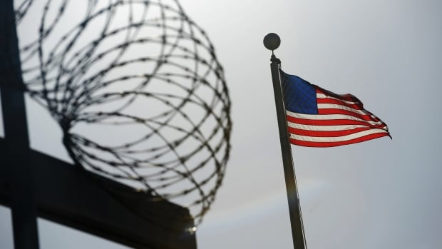 A U.S. flag flies above a detention facility at Guantanamo Bay, Cuba. Detainee Abd al-Hadi al-Iraqi is alleged to be behind attacks in Afghanistan that killed Canadian soldiers.