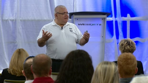 Vince Savoia, founder of the Tema Conter Memorial Trust, talks to first responders about post-traumatic stress disorder at a forum in Calgary on Tuesday.