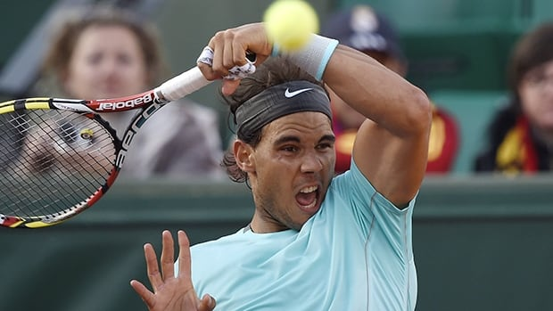 Spain's Rafael Nadal returns the ball to Spain's David Ferrer during their French Open quarter-final match at Roland Garros in Paris on Wednesday.