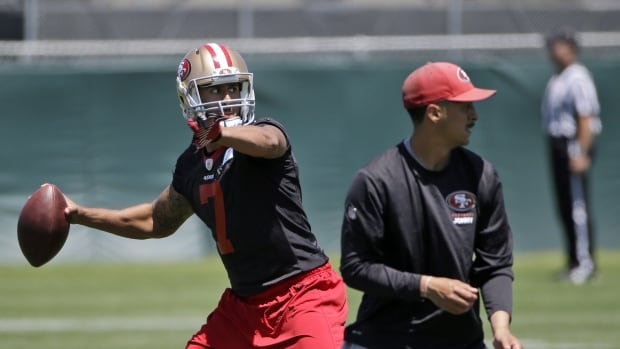 San Francisco 49ers quarterback Colin Kaepernick throws during an NFL football organized team activity on Tuesday.