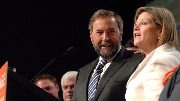 Federal NDP chief Tom Mulcair, seen with Ontario NDP Leader Andrea Horwath in Hamilton in 2012, is making his first appearance in the Ontario election Wednesday night in Toronto at a closed-door party fundraiser.