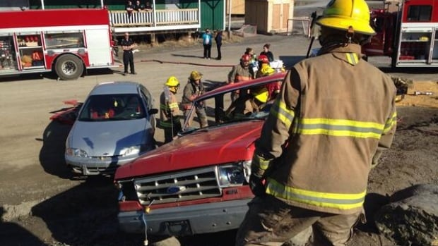 Firefighters and other emergency officials demonstrate a two-vehicle car crash involving a drunk driver.