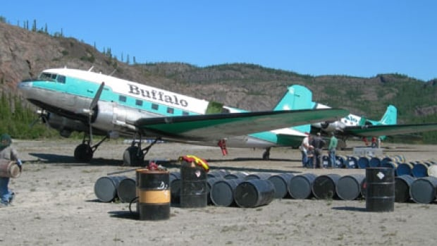 Two Buffalo Airways DC-3s at a Northern gravel airstrip in the summer of 2006. Buffalo Airways was in court Friday on charges of hauling diesel fuel in oversized tanks without proper certification and dangerous goods markings.