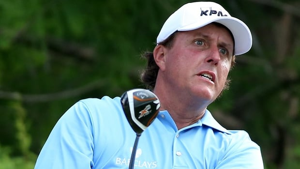 Phil Mickelson hits a shot from the 12th tee box in the FedEx St. Jude Classic at TPC Southwind in Memphis, Tenn., on Thursday.