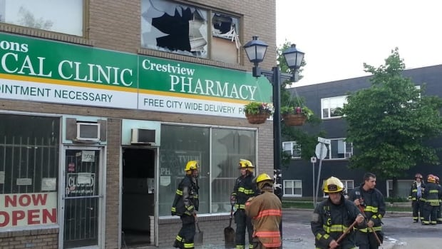 Crews clean up after putting out a fire at the Crestview Pharmacy at the corner of Ellice Avenue and Furby Street on Friday morning.