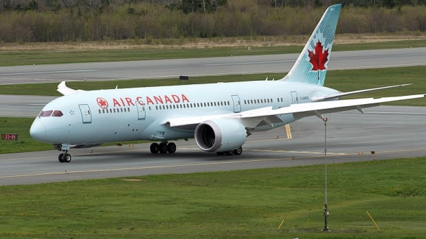 Air Canada's Boeing 787 Dreamliner jet arrives at Halifax Stanfield International Airport in Enfield, N.S. on its first commercial flight on May 23, 2014. The Dreamliner is one factor in a jump in stock prices for the airline.