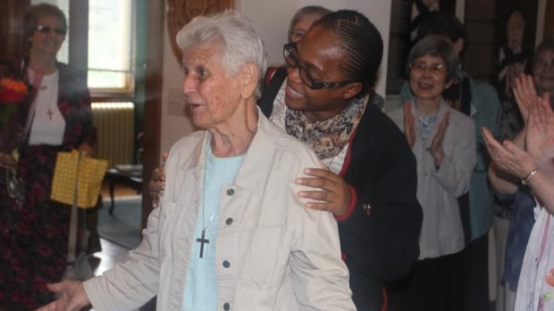 Sister Gilberte Bussière, 74, is reunited with her congregation of sisters in Montreal Friday, after being held captive for two months in Africa.