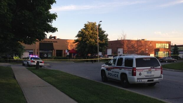 York Regional Police say that a man accused in a Friday night double shooting in Vaughan, Ont., has turned himself in.