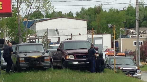 Police descended on a business in the Burnside industrial park Saturday afternoon.