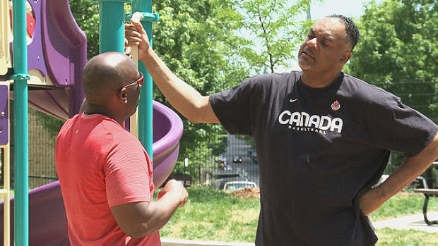 Dean Smith (left) and Wayne Yearwood catch up in Jessie Maxwell-Smith Park, which reopened on Friday after two years of waiting.