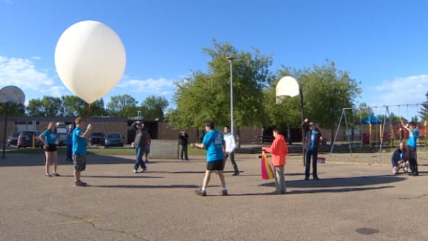 Students from the Sir George Simpson Junior High launched a weather balloon into the sky Saturday.
