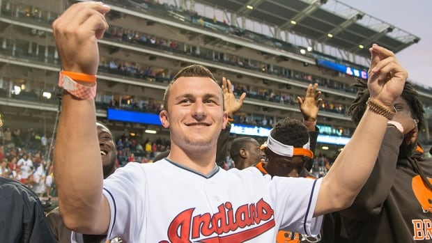 Rookie draft pick Johnny Manziel of the NFL Cleveland Browns acknowledges the crowd prior to the game between the Cleveland Indians and the Boston Red Sox on Wednesday. On Saturday, the San Diego Padres drafted Manziel in the 28th round.