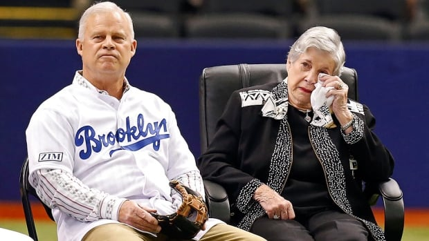 Soot Zimmer, right, widow of Don Zimmer, and son Tom Zimmer watch a video tribute during a ceremony honouring Don Zimmer prior to a baseball game between the Tampa Bay Rays and Seattle at Tropicana Field in St. Petersburg, Fla., on Saturday. A longtime baseball man, Don Zimmer died Wednesday at 83.