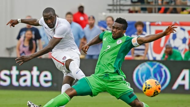 Jozy Altidore, left, scores a goal for the U.S. past Nigeria's Joseph Yobo during the second half of an international friendly soccer match in Jacksonville, Fla., on Saturday.