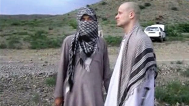 Some in U.S. Congress have questioned if the prisoner exchange for Bergdahl, shown above, right, moments before he was handed over to U.S. special forces in eastern Afghanistan, may jeopardize American security efforts.