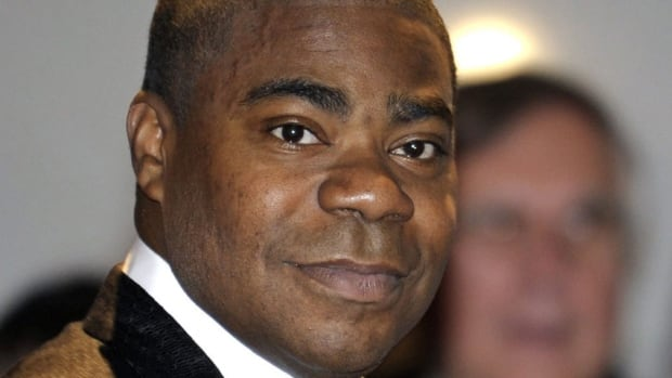 Tracy Morgan, seen in Washington in 2010, is improving in a New Jersey hospital, according to his spokesman.
