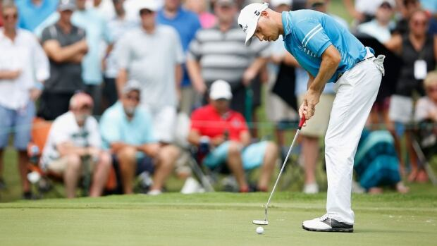 Ben Crane putts on the 17th green during the final round of the St. Jude Classic at the TPC Southwind in Memphis, Tenn., on Sunday. Crane closed with a 3-over 73 for a one-stroke victory over Troy Merritt, going wire to wire for his fifth PGA Tour victory.