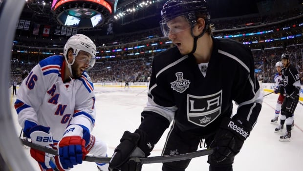 New York Rangers centre Derick Brassard, left, and Los Angeles Kings center Tyler Toffoli battle for the puck during the second overtime period in Game 2 on Saturday.