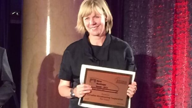 The CBC's Alison Smith accepts the RTDNA for best newscast at Saturday's awards gala.