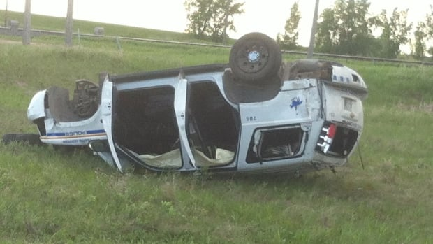 An RCMP officer suffered minor injuries and was not taken to hospital when his SUV rolled over at Wilkes Avenue and the Perimeter Highway on Sunday.