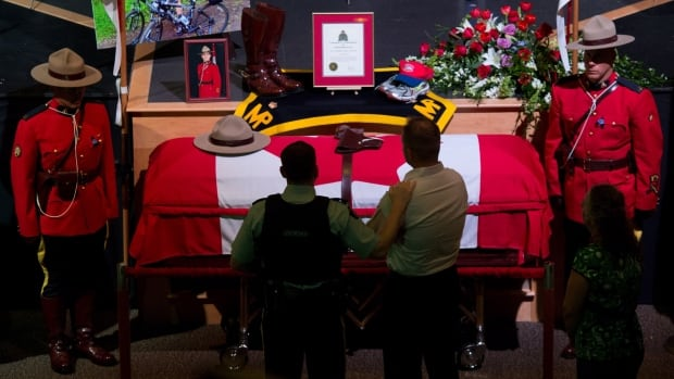 The casket of Const. Douglas James Larche, 40, from Saint John, N.B. rests at Wesleyan Celebration Centre during the public visitation in Moncton, N.B. on Monday.