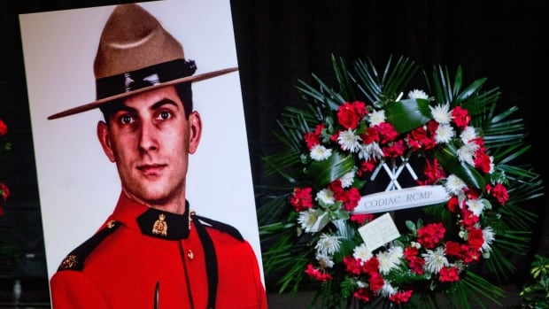 A portrait of Const. Doug Larche is displayed at Wesleyan Celebration Centre during the public visitation in Moncton in June.