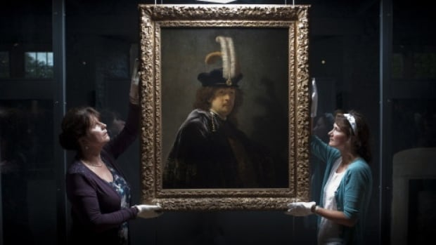 Staffers at Britain's National Trust display the painting, donated by a wealthy supporter in 2010 and now confirmed as a self-portrait of Rembrandt worth nearly $55 million Cdn.