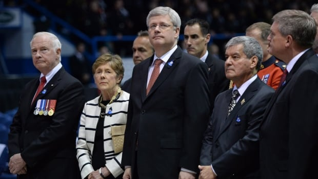 Prime Minister Stephen Harper stands next to Lt.-Gov. Graydon Nicholas at the recent funeral for three slain RCMP officers. Nicholas's term as New Brunswick's lieutenant-governor will end in September.