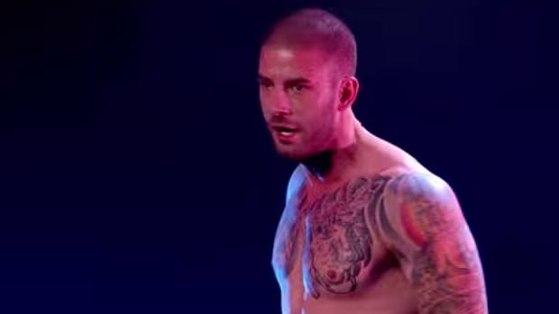 Darcy Oake walks away after dropping out of a straight-jacket with one second to spare before the jaws of a bear trap slammed shut.