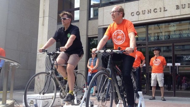 Mayor Sam Katz helps kicks off, or pedals off, the announcement for bike week on Tuesday morning at city hall. The two bikes powered the event's sound system.