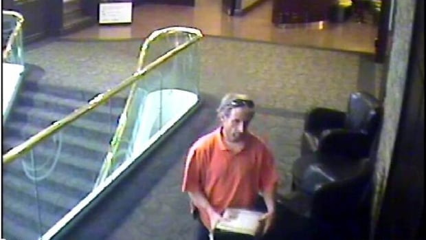 The suspect was seen leaving the Sheraton Hotel with the cash box containing $11,000.