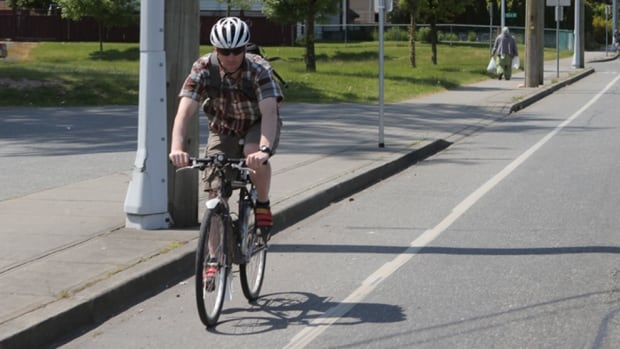 A cyclist travels through Surrey's expanding bike network.