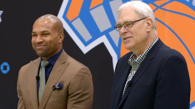 Derek Fisher, left, is introduced as Knicks head coach by team president Phil Jackson, right, in Greenburgh, N.Y., on Tuesday.